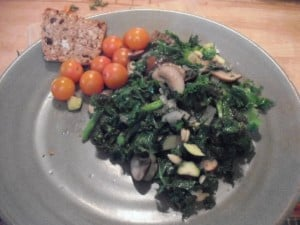 Plated kale and Broccoli Saute with cherry tomatoes