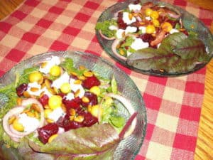 Two ground cherry salads, one with bacon and one without