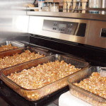 granola spread in baking dishes