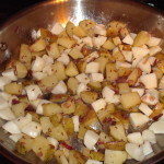 Potatoes and turnips in skillet.