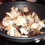 mushrooms in skillet with butter