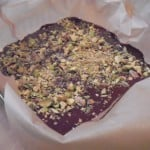 chocolate bark in pan, sprinkled with pistachios and salt