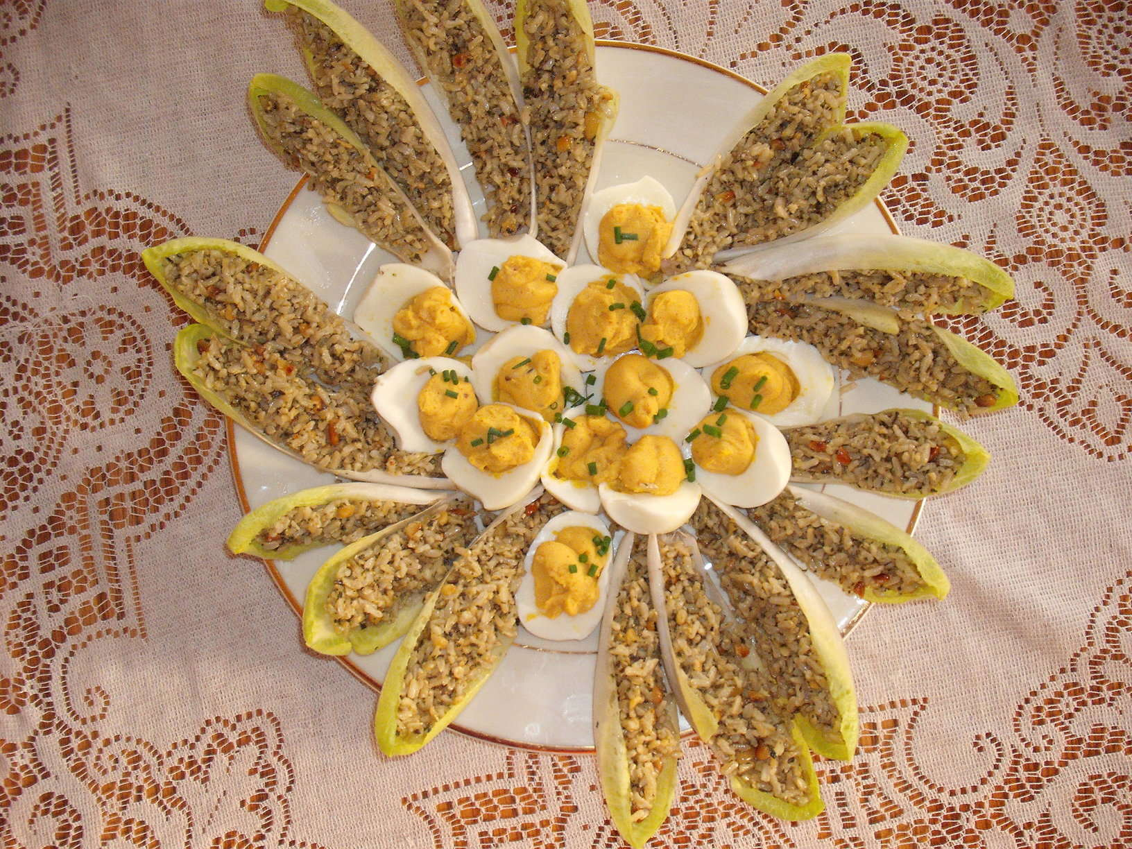 party platter featuring endive boats and deviled eggs