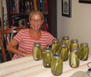 Me with finished jars of pickles