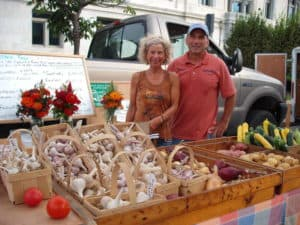 Me and my CSA farmer Bruce Haas, owner of Daydream Farm with all that garlic.