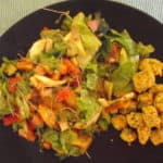 okra croutons on a plate with salad