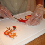 Technique for chopping hot peppers with gloves.