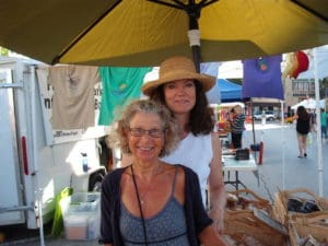 Susan and me at her market table.