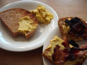 wheat toast with protein spread and bacon