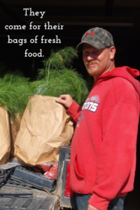 Keith Biver with CSA bags