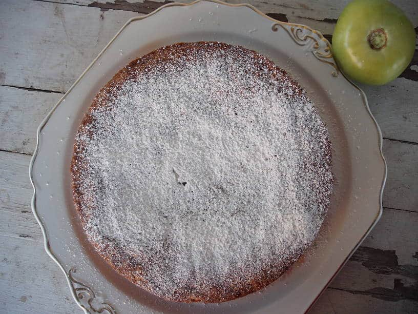 green tomato cake layer with powdered sugar sprinkle