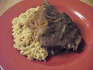 round steak with rice on plate