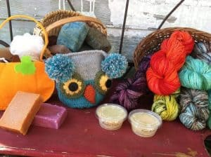 knitted hat, homemade soap and lotion and hand-dyed yarn