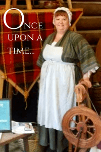Tracy in costume with spinning wheel