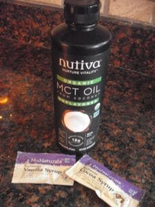 Bottle of Nutiva MCT Oil and packets of NuNaturals flavored sugar-free syrups