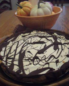 Pumpkin Cheesecake with chocolate chai cookie crust