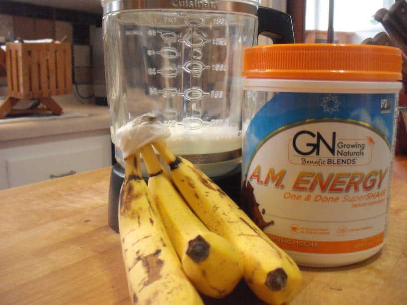kefir in blender jar, bunch of bananas and A.M. Energy One & Done SuperShake canister