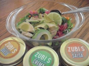 Zubi's samples with a bowl of crunchy vegetables for the tacos