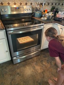 Hayley watches her cookies bake