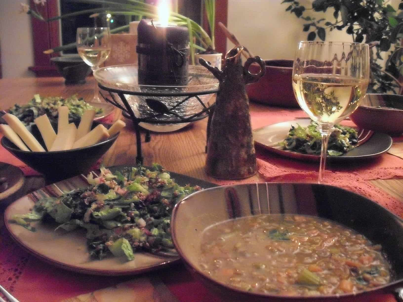 Country French Lentil Soup in a bowl alongside salad, local cheese and wine.